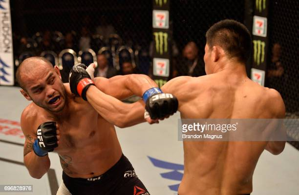 Li Jingliang of China and Frank Camacho of the Northern Mariana Islands trade punches in their welterweight bout during the UFC Fight Night event at...