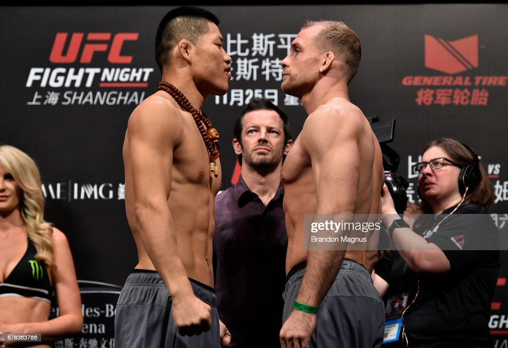 Li Jingliang of China and Zak Ottow face off during the UFC Fight Night weigh-in on November 24, 2017 in Shanghai, China.
