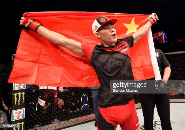 Li Jingliang of China celebrates after his decision victory over Frank Camacho of the Northern Mariana Islands in their welterweight bout during the...