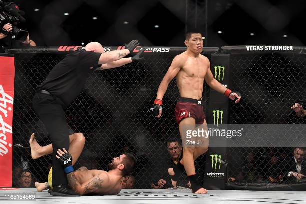 Li Jingliang of China celebrates after his TKO victory over Elizeu dos Santos of Brazil in their welterweight bout during the UFC Fight Night event...