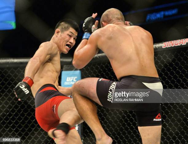 Li Jingliang of China competes against Frank Camacho of the Northern Mariana Island in the UFC welterweight event during the UFC Fight Night in...