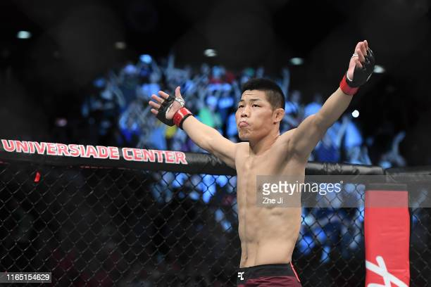 Li Jingliang of China prepares to fight Elizeu dos Santos of Brazil in their welterweight bout during the UFC Fight Night event at Shenzhen...
