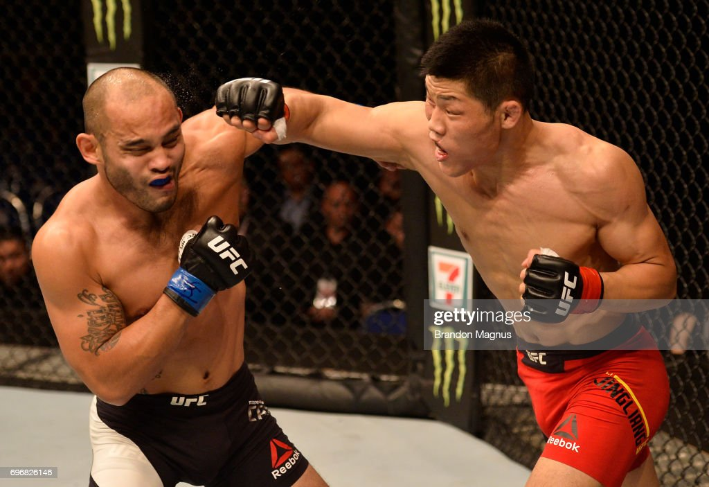 Li Jingliang of China punches Frank Camacho of the Northern Mariana Islands in their welterweight bout during the UFC Fight Night event at the Singapore Indoor Stadium on June 17, 2017 in Singapore.