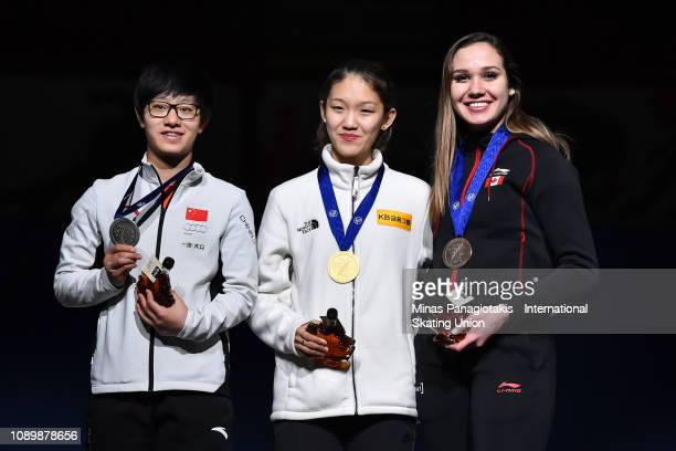Li Jinyu of China Seo Whi Min of Korea and Courtney Lee Sarault of Canada pose with their medals after finishing in the top three of the women's 1500...