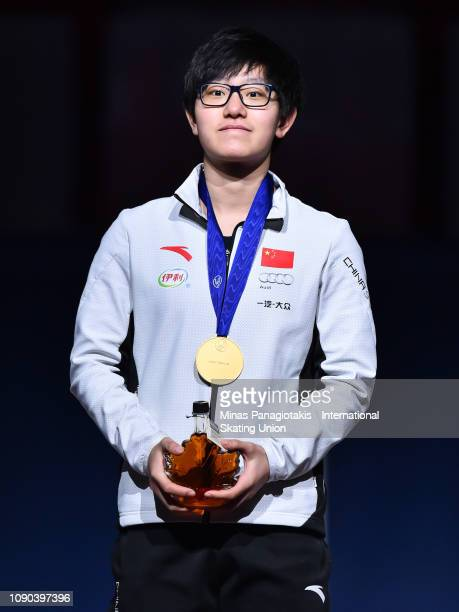 Li Jinyu of China stands on the podium with her gold medal after finishing first in the women's 1000m final during the ISU World Junior Short Track...