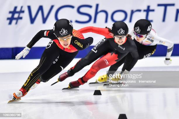 Li Jinyu of China takes the lead against Claudia Heeney of Canada and Park Yoon Jung of Korea in the women's 1000m final during the ISU World Junior...