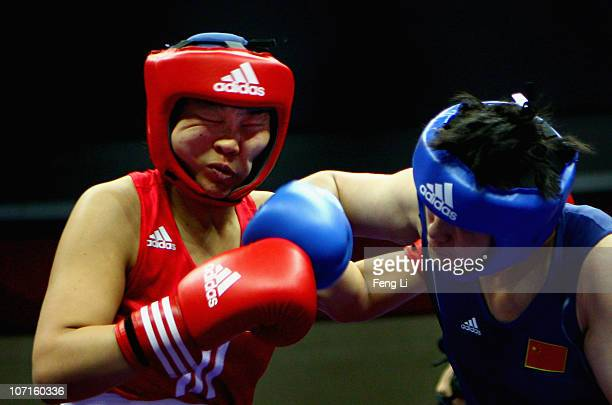 Li Jinzi of China competes with Undram Erdenesoyol of Mongolia in the Women's 6975kg Gold Medal match at Foshan Gynasium during day fourteen of the...