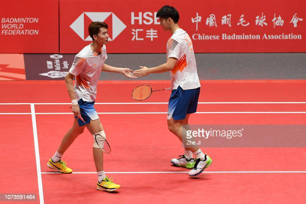 Li Junhui and Liu Yuchen of China celebrate after defeating Chen Hung Ling and Wang ChiLin of Chinese Taipei during their men's doubles semifinals...