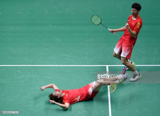 Li Junhui and Liu Yuchen of China celebrate after winning the Men's Doubles eighth-final match against Goh V Shem and Tan Wee Kiong of Malaysia on...