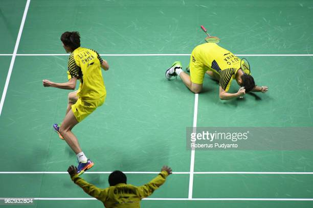 Li Junhui and Liu Yuchen of China celebrate victory after beating Yuta Watanabe and Keigo Sonoda of Japan during the Thomas Cup Final match on day...
