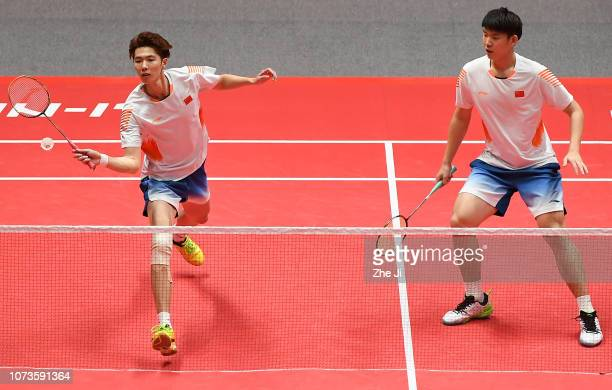 Li Junhui and Liu Yuchen of China compete against Chen Hung Ling and Wang ChiLin of Chinese Taipei during their men's doubles semifinals match on day...