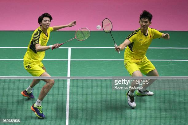 Li Junhui and Liu Yuchen of China compete against Yuta Watanabe and Keigo Sonoda of Japan during the Thomas Cup Final match on day eight of the BWF...