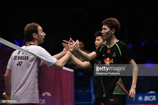 Li Junhui and Liu Yuchen of China greet Mathias Boe and Carsten Mogensen of Denmark during Men's Double Final match of the BCA Indonesia Open 2017 at...