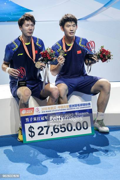 Li Junhui and Liu Yuchen of China pose with gold medals on the podium after winning the men's doubles against Taseshi Kamura and Keigo Sonda of Japan...