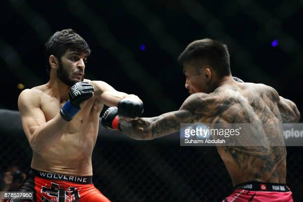 Li Kai Wen of China fights Ahmed Mujtaba of Pakistan in the Featherweight bout during ONE Championship Immortal Pursuit at the Singapore Indoor...