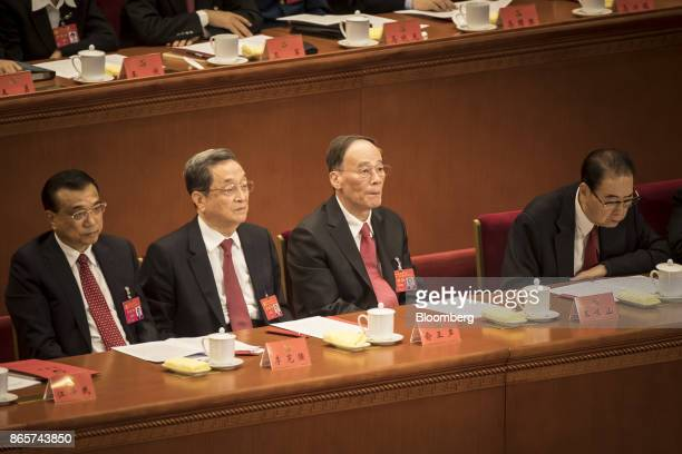 Li Keqiang China's premier from left Yu Zhengsheng chairman of the Chinese People's Political Consultative Conference Wang Qishan secretary of the...