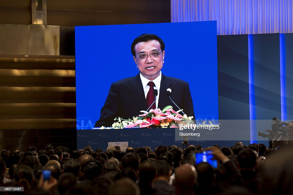 Li Keqiang, China's premier, is seen on a screen as he delivers a speech at the Boao Forum for Asia in Boao, Hainan, China, on Thursday, April 10, 2014. Li said China plans to connect the stock exchanges of Hong Kong and Shanghai as part of efforts to expand the nations capital markets. Photographer: Brent Lewin/Bloomberg via Getty Images