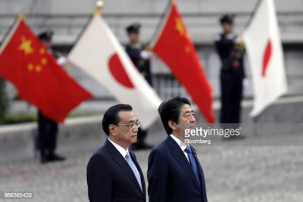 Li Keqiang China's premier left and Shinzo Abe Japan's prime minister observe an honor guard in Tokyo Japan on Wednesday May 9 2018 As Abe welcomed...