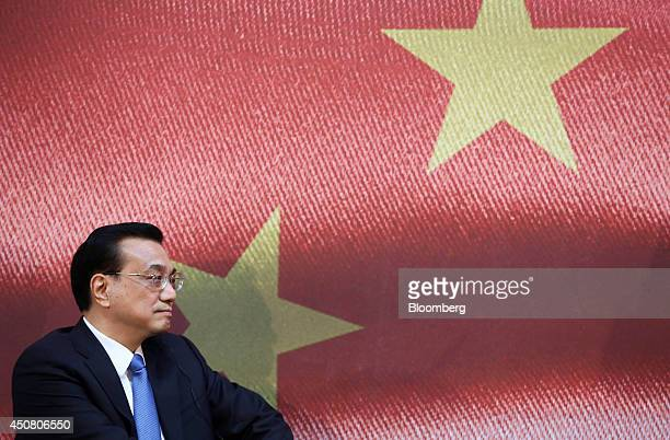 Li Keqiang China's premier listens during the UK China Financial Forum at Lancaster House in London UK on Wednesday June 18 2014 China Construction...