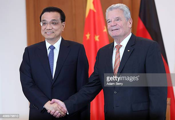 Li Keqiang premier of the People's Republic of China and party secretary of the State Council shakes hands at Bellevue presidential palace with...