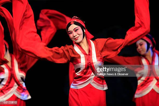 Li Li center and other Chinese dancers perform their number during the 27th International Festival of Raleigh at the Raleigh Convention Center Sunday...