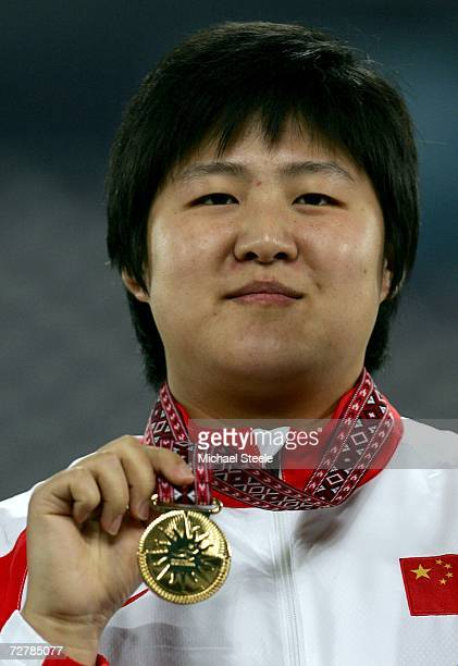 Li Ling of China celebrates gold in the Women's Shot Put Medal Ceremony during the 15th Asian Games Doha 2006 at the Khalifa Stadium December 9 2006...