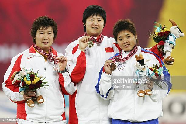 Li Ling of China celebrates gold Li Meiju of China silver and Lin Chia Ying of Chinese Taipei in the Women's Shot Put Medal Ceremony during the 15th...
