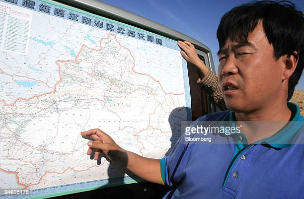 Li Lixin the head of the desert highway project execution office under the Xinjiang government points a map where the second desert highway under...