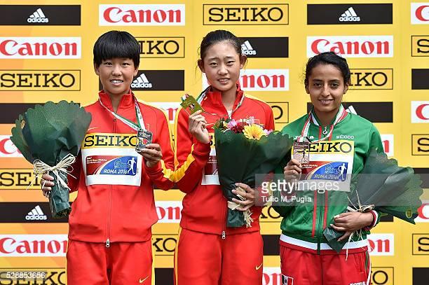 Li Ma Zhenhia MA and Valeria Ortuno show their medals after the woman's 10Km Race Walk as her team mate Li MA arrives second at IAAF World Race...