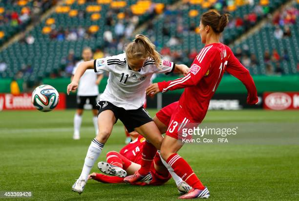 Li Mengwen of China PR challenges Theresa Panfil of Germany at Commonwealth Stadium on August 8 2014 in Edmonton Canada