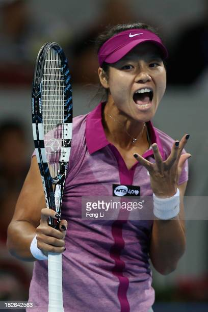 Li Na of China celebrates winning a ball against Sabine Lisicki of Germany during her women's singles match on day five of the 2013 China Open at the...