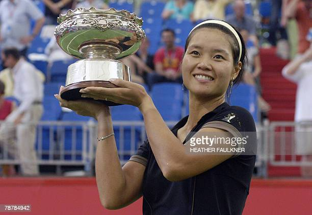 Li Na of China is seen in with the winners trophy after defeating Victoria Azarenka of Belarus during the final of the match of the Australian...