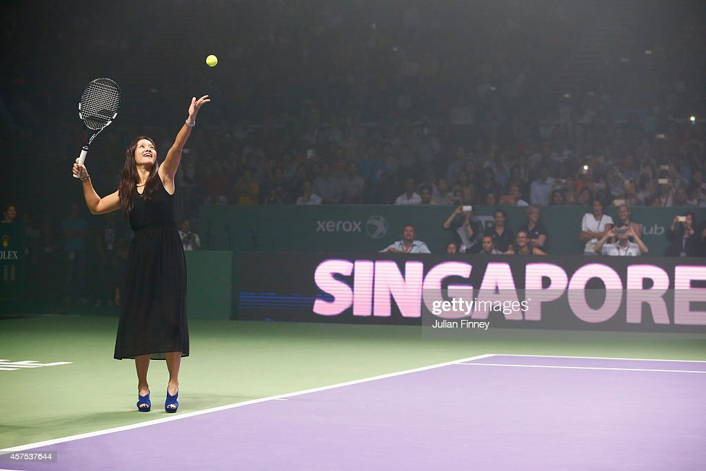 Li Na of China makes the first serve to open the event during day one of the BNP Paribas WTA Finals tennis at the Singapore Sports Hub on October 20, 2014 in Singapore.