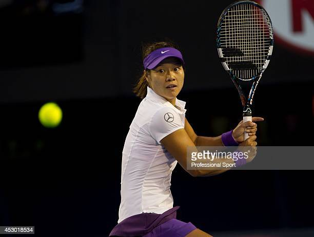 Li Na of China plays a backhand in her women's final match against Victoria Azarenka of Belarus during day thirteen of the 2013 Australian Open at...