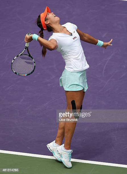 Li Na of China serves against Serena Williams of the United States during their final match during day 13 at the Sony Open at Crandon Park Tennis...