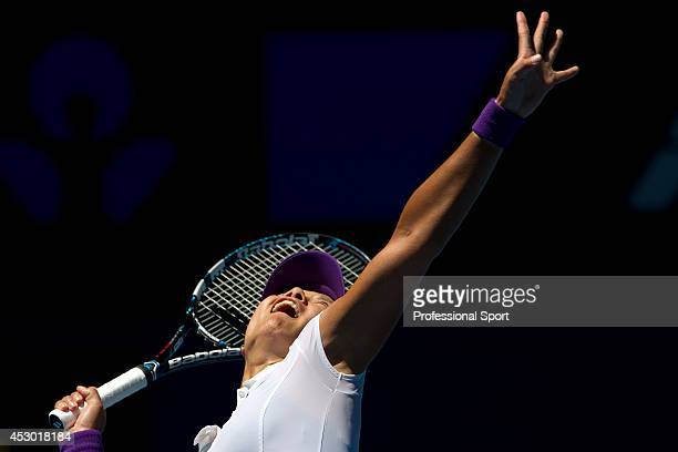 Li Na of China serves in her semi-final match against Maria Sharapova of Russia during day eleven of the 2013 Australian Open at Melbourne Park on...