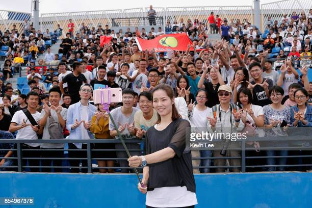 Li Na of China takes a selfie with students after the tennis clinic at 2017 Wuhan Open on September 28 2017 in Wuhan China