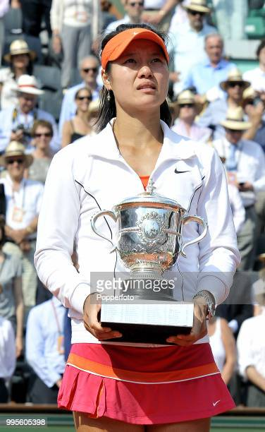 Li Na of China with the trophy after winning the Women's Singles Final in straight sets against Francesca Schiavone of Italy during day 14 of the...