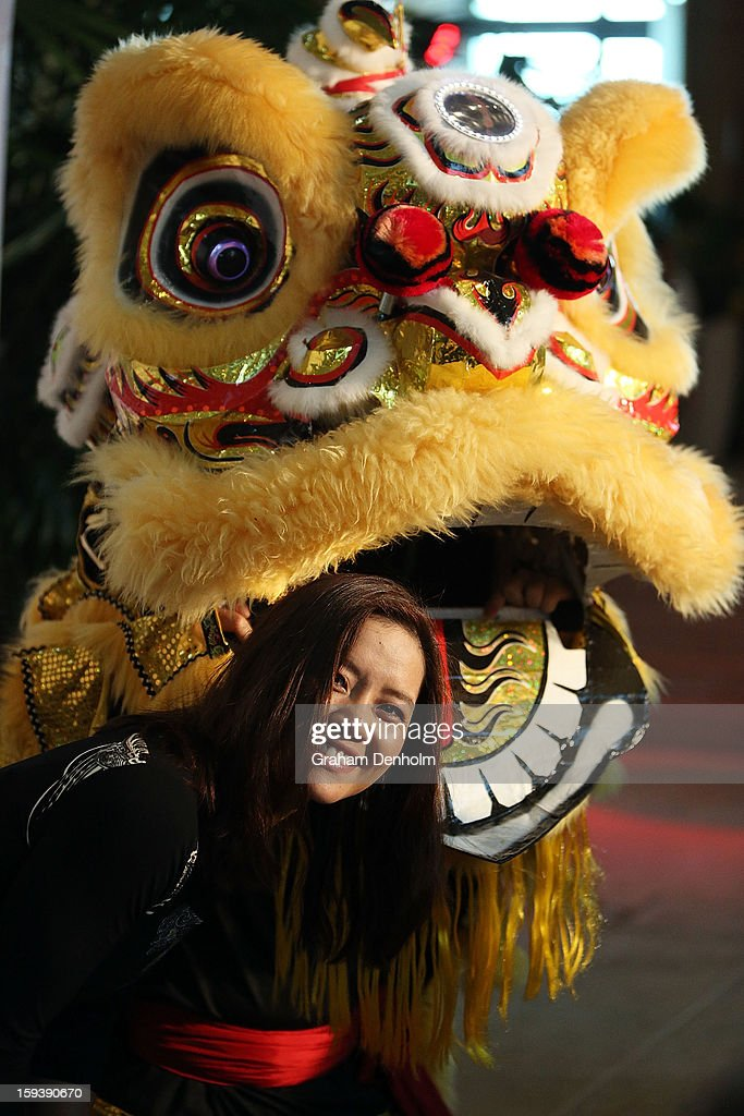 Li Na poses with a chinese dragon as she arrives at Crown's IMG Tennis Player's Party at Crown Towers on January 13, 2013 in Melbourne, Australia.