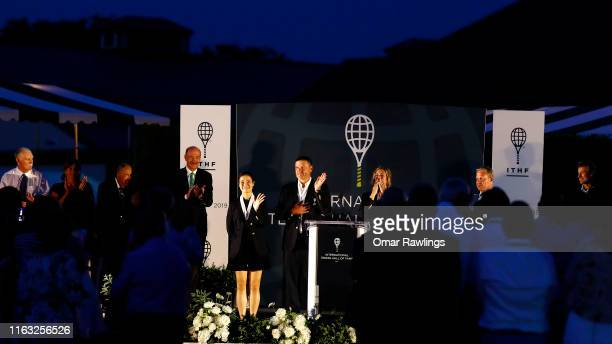 Li Na Yevgeny Kafelnikov and Mary Pierce wave to the crowd after being inducted to the International Tennis Hall of Fame on July 20 2019 in Newport...