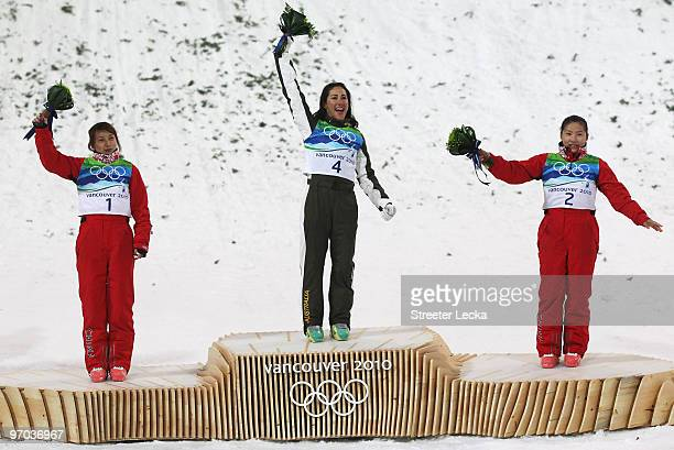 Li Nina of China celebrates winning silver Lydia Lassila of Australia gold and Guo Xinxin of China bronze during the flower ceremony for the...