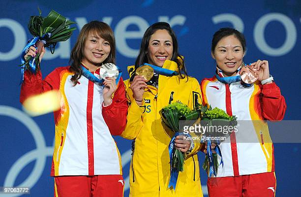 Li Nina of China receives the silver medal Lydia Lassila of Australia receives the gold medal and Guo Xinxin of China receives the bronze medal...