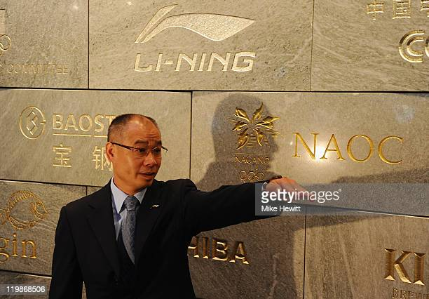 Li Ning Chairman of Li Nin poses for a picture during the Li Ning donation ceremony to the Olympic Museum on July 26 2011 in Lausanne Switzerland Li...