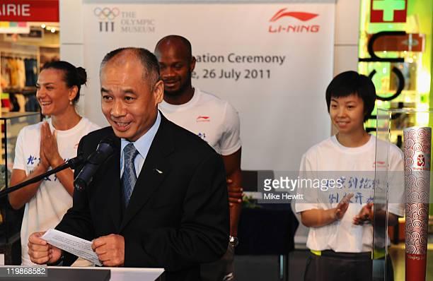Li Ning Chairman of Li Ning makes a speech as Yelena Isinbayeva of Russia Asafa Powell of Jamaica and Zhang Yining of China look on during the Li...