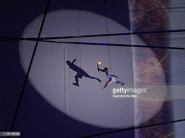 Li Ning flies with the torch around the top of the National Stadium during the opening ceremony on Friday August 8 to kick off the Games of the XXIX...