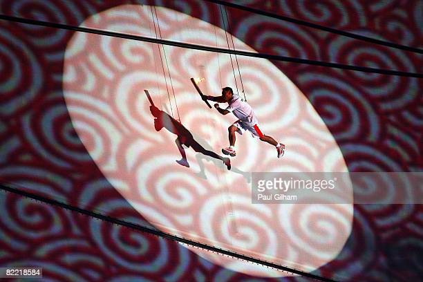 Li Ning former Olympic gymnast for China flys through the air on his way to lighting the Olympic Flame during the Opening Ceremony for the 2008...