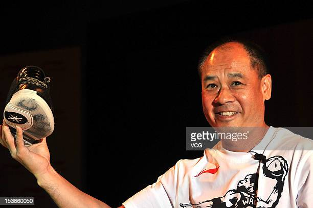 Li Ning founder and chairman of Li Ning Co poses during a press conference after signing contract with Dwyane Wade at Grand Hyatt Hotel on October 10...