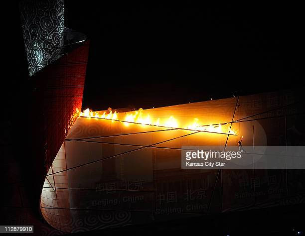Li Ning lights the cauldron in the National Stadium during the opening ceremony on Friday August 8 to kick off the Games of the XXIX Olympiad in...