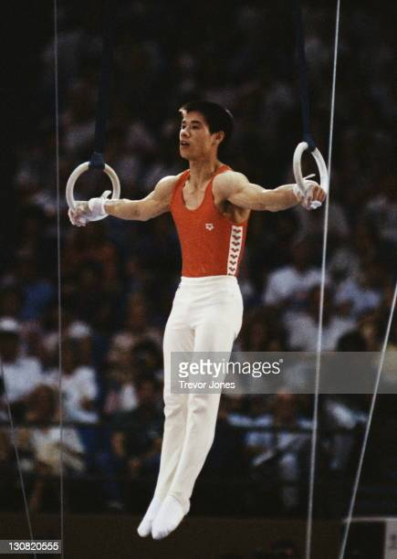 Li Ning of China performs the crucifix position during the Men's Gymnastics Rings event on 4th August 1984 during the XXIII Olympic Summer Games at...