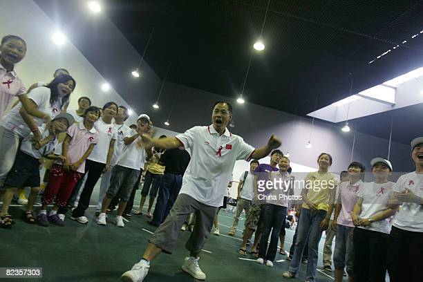 Li Ning who lit up the Beijing Olympic cauldron attends a charity activity themed 'Joyful Olympics' with AIDS orphans on August 14 2008 in Beijing...